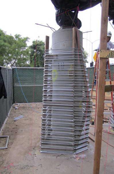 Butch then surrounded the wrapped pillars with a framework of rebar and chicken wire. The shotcrete applied by filled